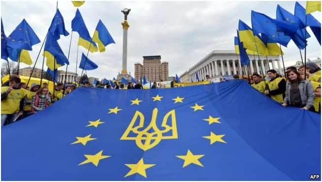 The Youth holds the EU flag with the emblem of Ukraine on Independence Square in Kyiv